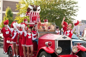 Mascot Bucky Badger and cheerleaders from the UW Spirit Squad drive along Regent Street in the Bucky Wagon before the Wisconsin vs. Penn State University football game at Camp Randall Stadium at the University of Wisconsin-Madison on Oct. 11, 2008. Penn State won the game, 48-7